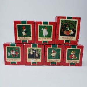 1997 Hallmark 7 handcrafted ornaments.